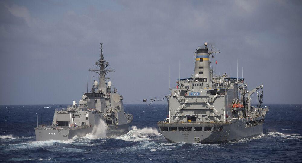 Japan Maritime Self-Defense Force guided-missile destroyer JS Atago (DDG 177) and USNS Pecos (T-AO 197). (File)