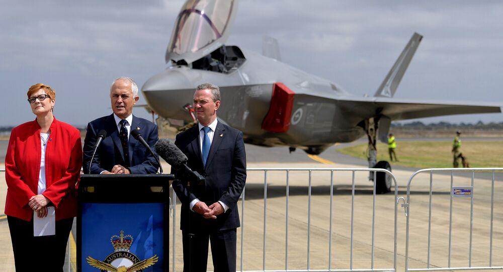 Australian Prime Minister Malcolm Turnbull speaks next to Minister for Defence, Senator Marise Payne and Minister for Defence Industry, Christopher Payne.