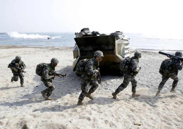 South Korean Marines run after they landed on the beach during the U.S.-South Korea joint landing military exercises as a part of the annual joint military exercise Foal Eagle between South Korea and the United States in Pohang, south of Seoul, South Korea. (File)
