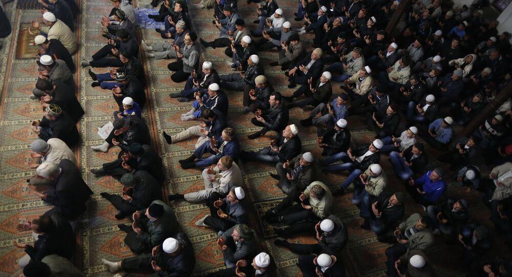 Crimean Tatars pray in a mosque marking the Eid al-Adha, celebrated by Muslims worldwide, in Bakhchisarai, Crimea. (File)