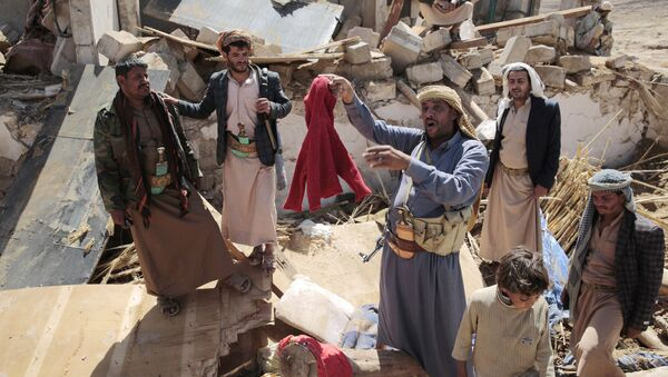A man center, holds house destroyed by a Saudi-led airstrikes in outskirts of Sanaa, Yemen, Thursday, Feb. 16, 2017. - Sputnik International