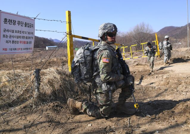 US soldiers take a position during their drill at a military training field in the border city of Paju on March 7, 2017. The US military has begun deploying the THAAD anti-ballistic missile defense system to South Korea, US Pacific Command said, with its first elements arriving on March 6, to protect against threats from North Korea