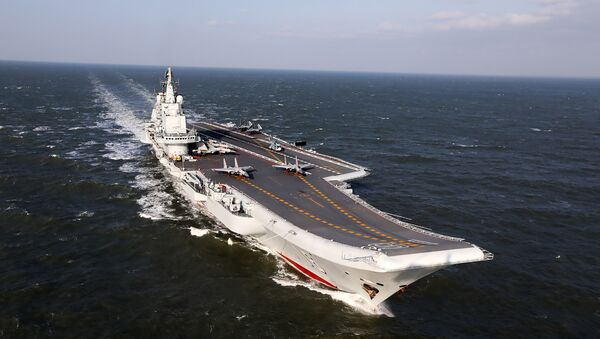 December 24, 2016 shows the Liaoning, China's only aircraft carrier, sailing during military drills in the Pacific - Sputnik International