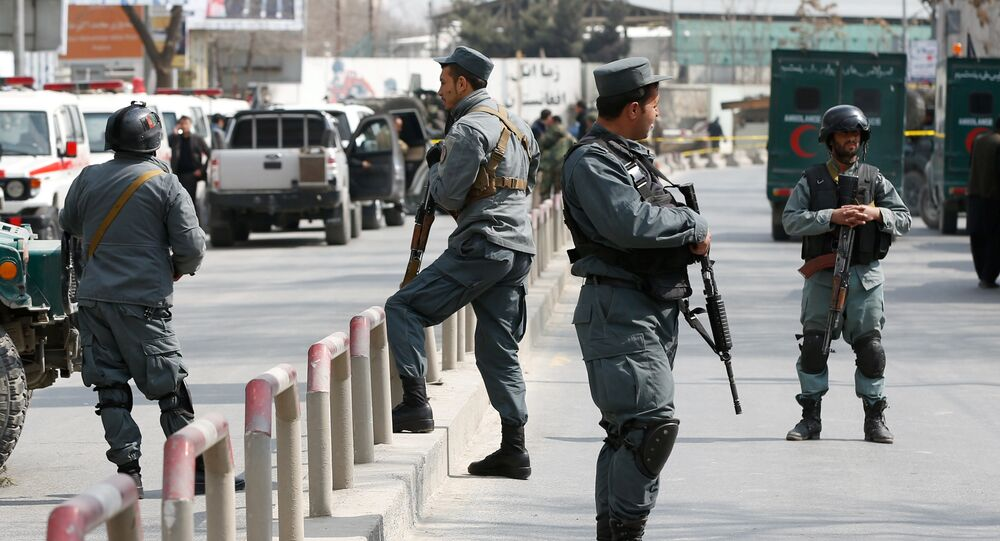 Afghan policemen keep watch at the site of a blast and gunfire at a military hospital in Kabul, Afghanistan March 8, 2017