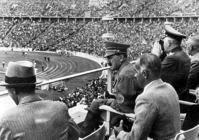 Dr. Joseph Goebbels, German Chancellor Adolf Hitler, Reichs Sports Leader Hans von Tschammer und Osten and Generalfeldmarschall Werner von Blomberg observe the Olympic Games in Berlin, Germany in August 1936