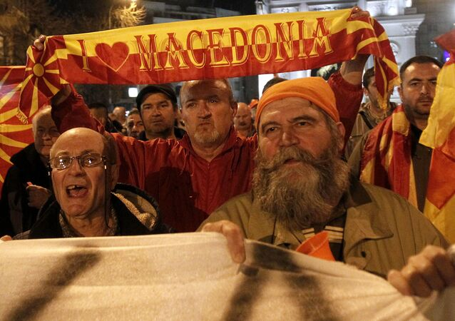 People protest marching through a street in Skopje, Macedonia, on Thursday, March 2, 2017