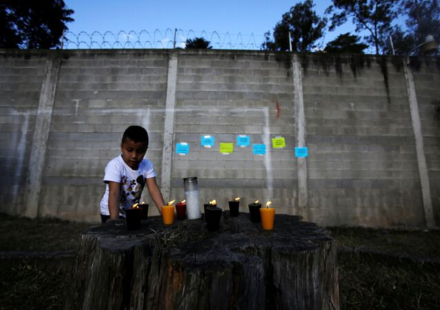 Candles are lit for victims after a fire broke out at the Virgen de Asuncion home in San Jose Pinula on the outskirts of Guatemala City, March 8, 2017