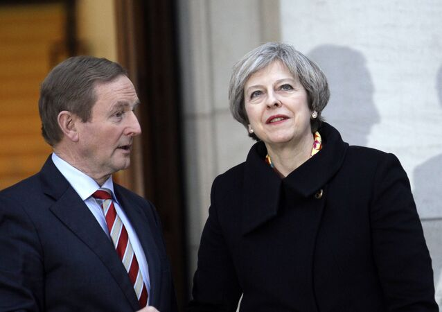British Prime Minister Theresa May, right, talks with Irish Prime Minister Enda Kenny after arriving for a meeting at government buildings, Dublin, Ireland, Monday, Jan. 30, 2017.