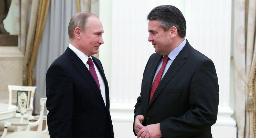 Vladimir Putin at a meeting with German Foreign Minister Sigmar Gabriel