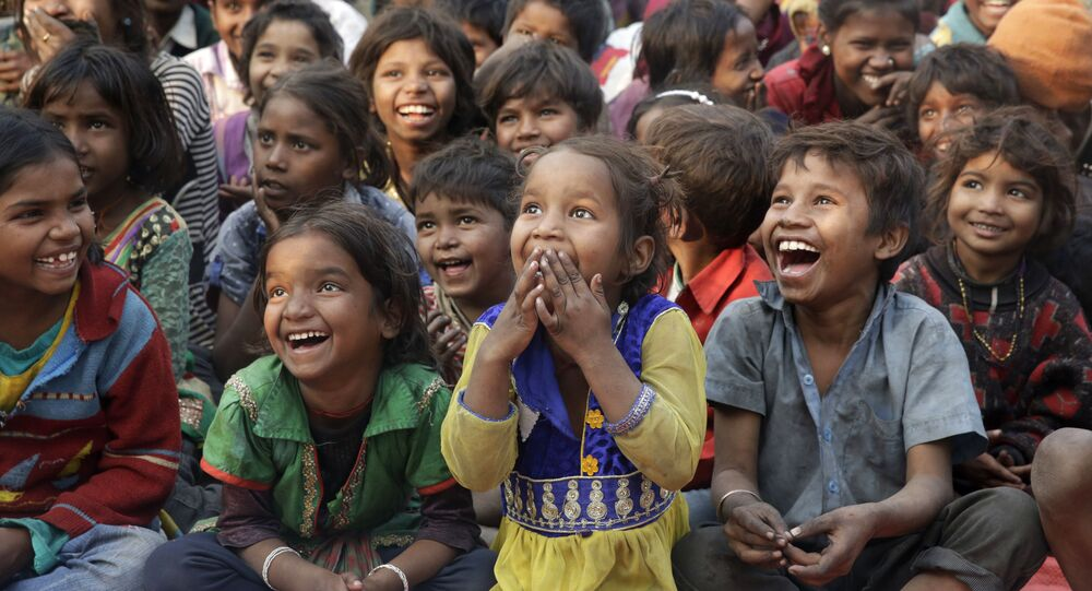 Jan. 17, 2017 photo, impoverished Indian children watch a performance as part of advocacy against child labor in Allahabad, India