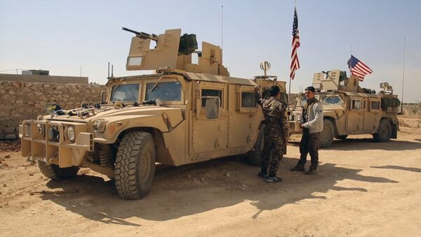 March 7, 2017 frame grab from video provided by Arab 24 network, shows fighters from the Syrian Democratic forces standing near U.S military vehicles on the outskirts of the Syrian town, Manbij, a flashpoint between Turkish troops and allied Syrian fighters and U.S.-backed Kurdish fighters, in al-Asaliyah village, Aleppo province, Syria - Sputnik International