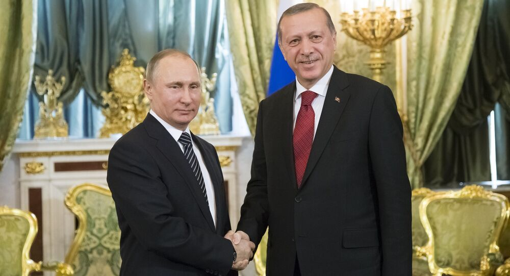 Russian President Vladimir Putin, left, shakes hands with Turkey's President Recep Tayyip Erdogan during their meeting in the Kremlin in Moscow, Russia, Friday, March 10, 2017
