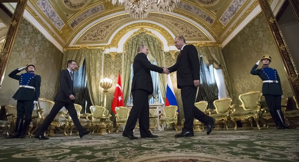 Russian President Vladimir Putin, second left, shakes hands with Turkey's President Recep Tayyip Erdogan during their meeting in the Kremlin in Moscow, Russia, Friday, March 10, 2017