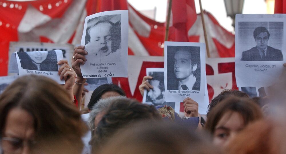 Relatives of Argentine disappeared during the Dirty War hold their photos in front of the Congress in Buenos Aires, Argentina Thursday. Augus 12, 2003.