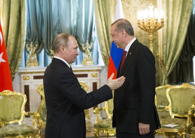 Russian President Vladimir Putin, left, speaks to Turkey's President Recep Tayyip Erdogan during their meeting in the Kremlin in Moscow, Russia, Friday, March 10, 2017