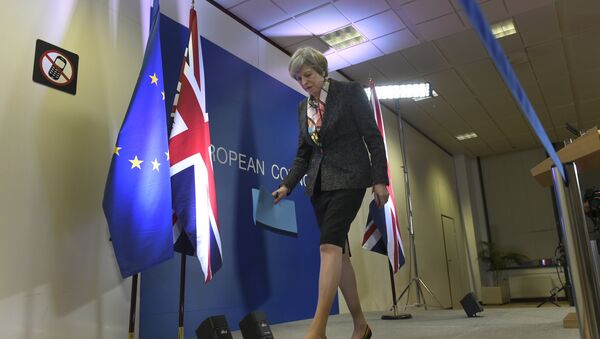British Prime Minister Theresa May leaves after a press conference during a European Summit at the EU headquarters in Brussels on March 9, 2017 - Sputnik International