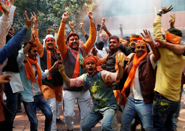 Supporters of India's Bharatiya Janata Party (BJP) celebrate after learning of the initial poll results at the party headquarters in Lucknow, India March 11, 2017
