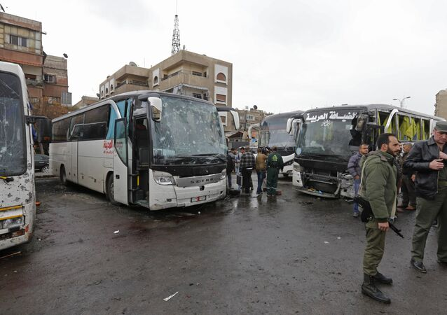 Syrian security forces and locals gather at the scene of a bombing following twin attacks targeting Shiite pilgrims in Damascus' Old City on March 11, 2017, in one of the bloodiest attacks in the Syrian capital