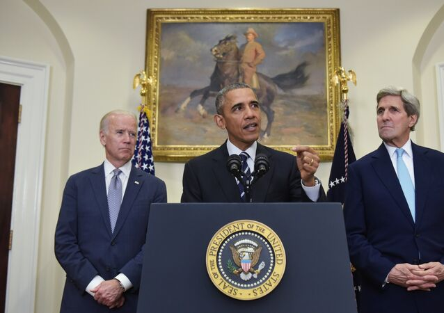 US President Barack Obama speaks on the Keystone XL pipeline, flanked by Secretary of State John Kerry (R), and Vice President Joe Biden, on November 6, 2015 in the Roosevelt Room of the White House in Washington, DC.