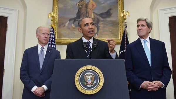 US President Barack Obama speaks on the Keystone XL pipeline, flanked by Secretary of State John Kerry (R), and Vice President Joe Biden, on November 6, 2015 in the Roosevelt Room of the White House in Washington, DC. - Sputnik International