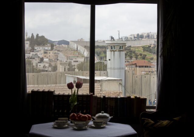 An Israeli security watch tower is seen from one of the rooms of the The Walled Off Hotel in the West Bank city of Bethlehem, Friday, March 3, 2017.