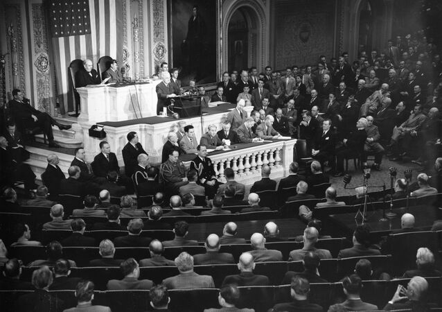 U.S. President Harry S. Truman, standing at podium, addresses a joint session of Congress in the House Chamber in Washington, D.C., March 12, 1947.