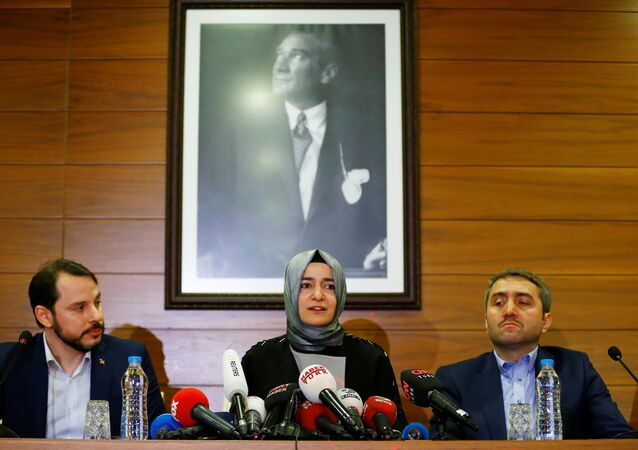 Turkey's Family and Social Affairs Minister Fatma Betul Sayan Kaya (C) speaks during a news conference at Ataturk International airport in Istanbul, Turkey, March 12, 2017.
