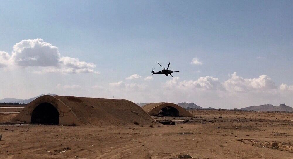 An Mi-28 helicopter flies over the environs of Ancient Palmyra in Homs Governorate, Syria