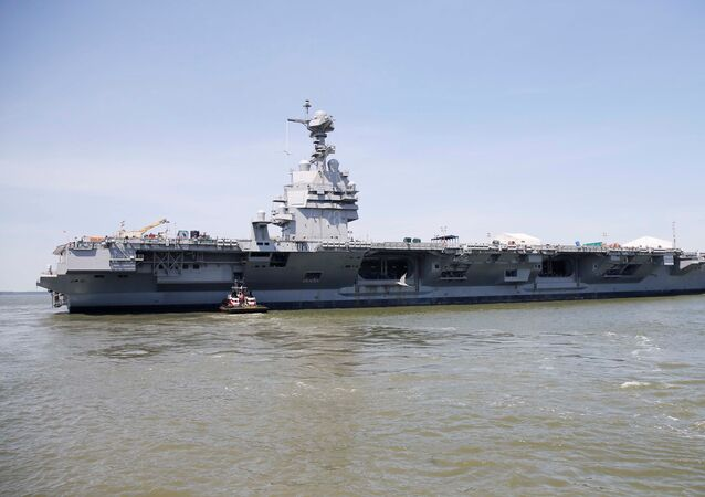 Pre-Commissioning Unit Gerald R. Ford (CVN 78) is maneuvered by tug boats in the James River during the aircraft carrier's turn ship evolution in Newport News, Virginia, U.S. June 11, 2016.