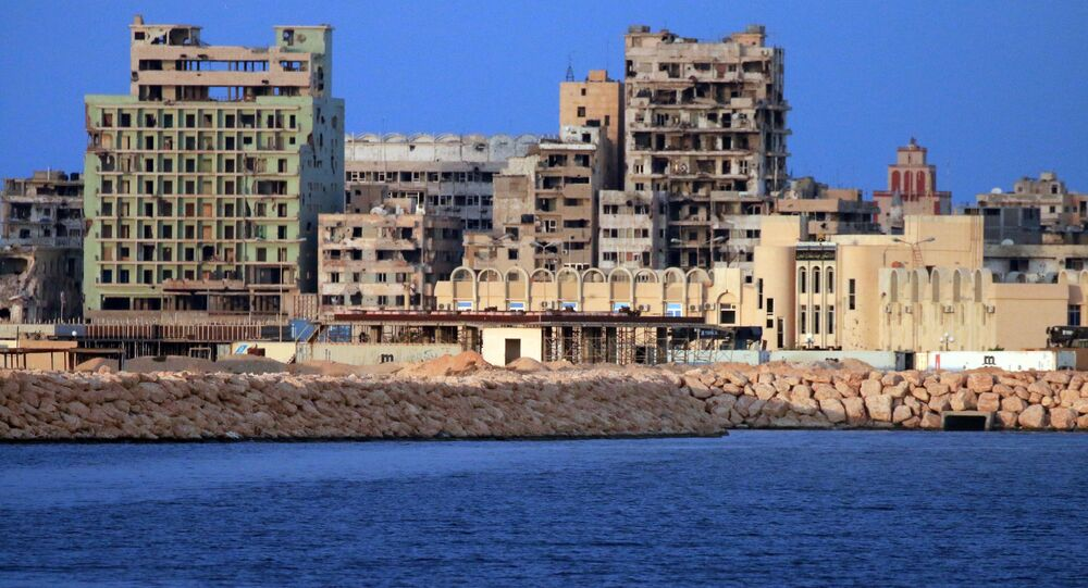 A picture taken on a boat of Libyan naval forces during a patrol shows a view of buildings, including abandoned Omar Khayyam hotel, in the port district in Libya's second city Benghazi on November 20, 2016