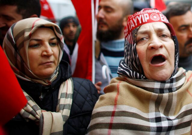 People shout slogans during a protest in front of the Dutch Consulate in Istanbul, Turkey, March 12, 2017.
