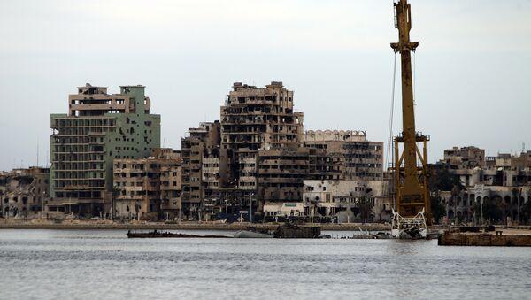 A general view shows destroyed buildings in Libya's eastern coastal city of Benghazi (file) - Sputnik International