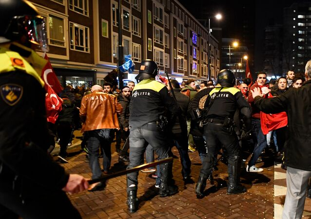 Demonstrators clash with riot police during running battles in the streets near the Turkish consulate in Rotterdam, Netherlands March 12, 2017.
