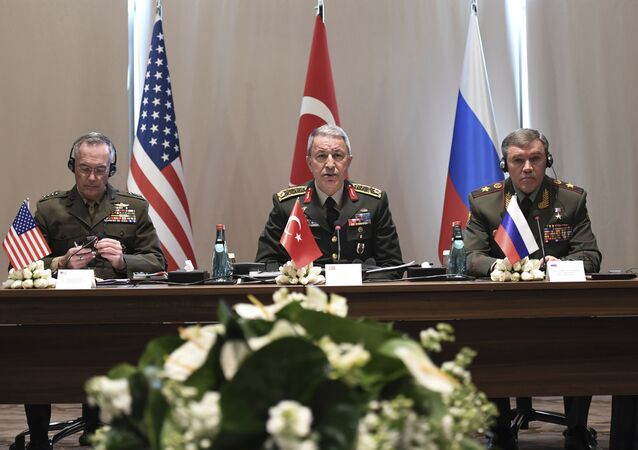 Turkey's Chief of Staff Gen. Hulusi Akar, center, U.S. Chairman of the Joint Chiefs of Staff Gen. Joseph Dunford, left, and Russia's Chief of Staff Gen. Valery Gerasimov attend a meeting in the Mediterranean coastal city of Antalya, Turkey