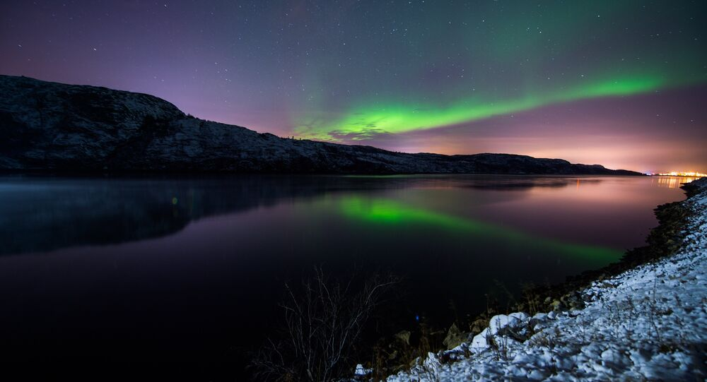 The Aurora Borealis or Northern Lights illuminate the night sky on November 12, 2015 near the town of Kirkenes in northern Norway.