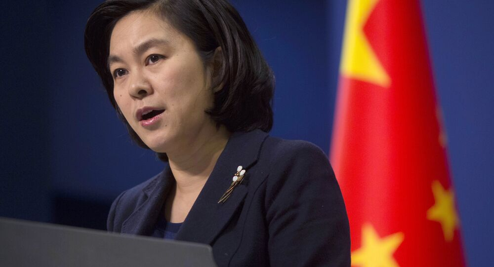 In this Wednesday, January 6, 2016, file photo, Chinese Foreign Ministry spokeswoman Hua Chunying speaks during a briefing at the Chinese Foreign Ministry in Beijing, China.