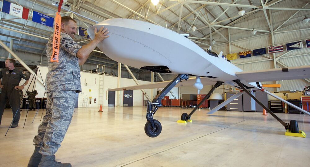 Military personnel adjust the placement of the US Air Force MQ-1 Predator aircraft at March Air Reserve Base in Riverside County, Calif., June 25, 2008.