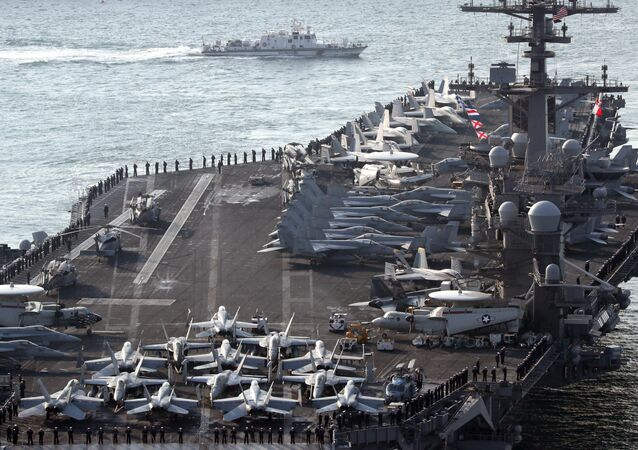 U.S. aircraft carrier USS Carl Vinson arrives for an annual joint military exercise called Foal Eagle between South Korea and U.S, at the port of Busan, South Korea, March 15, 2017.