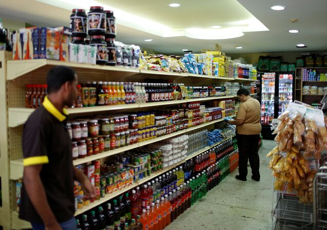 People look for groceries and goods at a supermarket in Caracas, Venezuela March 9, 2017.
