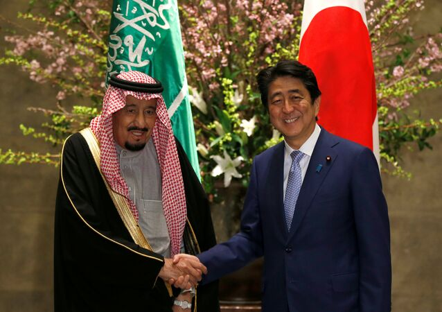 Saudi King Salman bin Abdulaziz Al-Saud (L) and Japan's Prime Minister Shinzo Abe shake hands before their meeting at Abe's official residence in Tokyo, Japan, March 13, 2017.