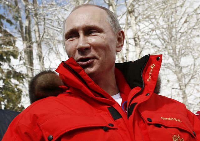 Russian President Vladimir Putin speaks during his meeting with Russian athletes, winners of the cross country 4x2.5km open relay, at the 2014 Winter Paralympic, Saturday, March 15, 2014, in Krasnaya Polyana, Russia. (File)