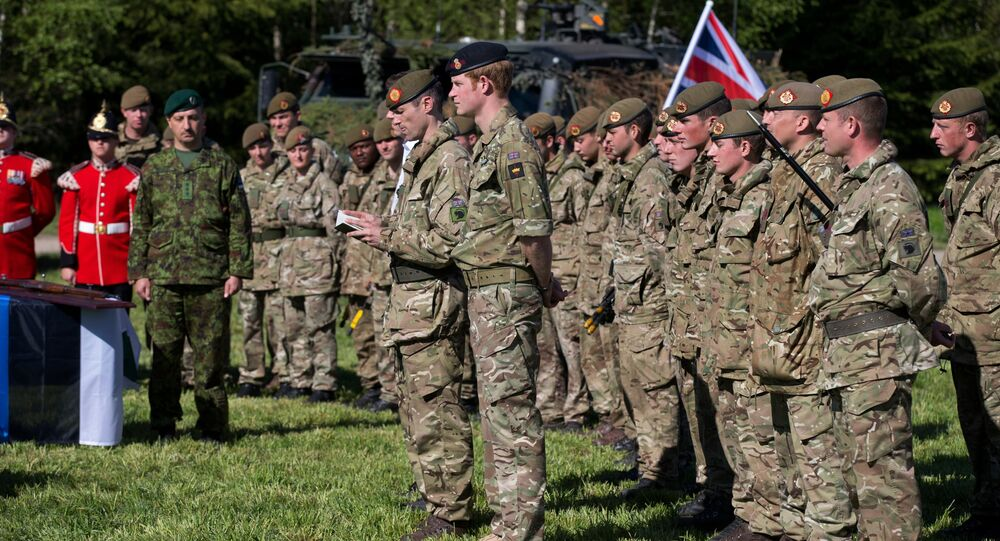 Britain's Prince Harry attends a special ceremony with presentation of the British Certificates of Commendation to Estonian servicemen during NATO's Spring Storm exercise in Otepaa, Estonia, Saturday, May 17, 2014.