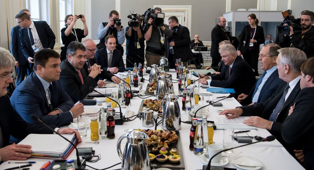Ukraine's Foreign Minister Pavlo Klimkin (2ndL), German Foreign Minister Sigmar Gabriel (3rdL), French Foreign Minister Jean-Marc Ayrault (2ndR) and Russian Foreign Minister Sergei Lavrov (3rdR) sit down for talks in the so-called Normandy format at the 53rd Munich Security Conference (MSC) at the Bayerischer Hof hotel in Munich, southern Germany, on February 18, 2017