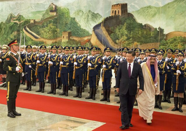 Chinese President Xi Jinping, second from right, and Saudi Arabia's King Salman, right inspect a Chinese guard of honor during a welcome ceremony in Beijing, China, Thursday, March 16, 2017