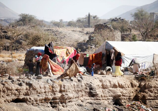 People are pictured near their tent at a camp for internally displaced people in Dharawan, near the capital Sanaa, Yemen February 28, 2017