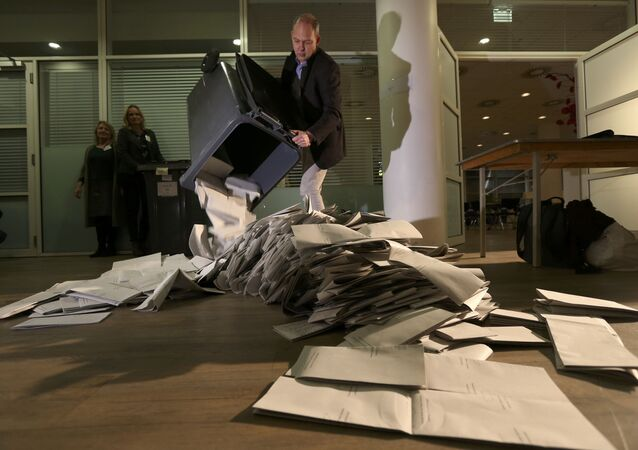 Ballots are emptied for counting as polling stations close in The Hague, Netherlands, March 15, 2017