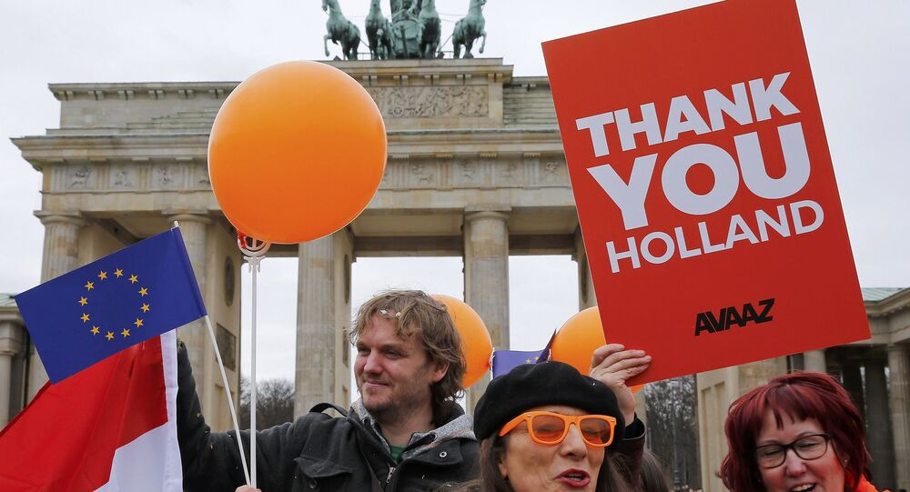 People hold placards to support the election results in the Netherlands during a demonstration in front of the Brandenburg Gate in Berlin, Germany, March 16, 2017.