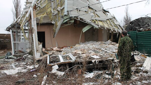 A damaged building in the village of Spartak in the Donetsk Region, affected by shelling - Sputnik International