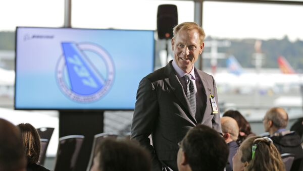 Pat Shanahan, senior vice president of Airplane Programs for Boeing Commercial Airplanes, greets guests at a re-opening ceremony for Boeing's newly expanded 737 delivery center, Monday, Oct. 19, 2015, at Boeing Field in Seattle - Sputnik International