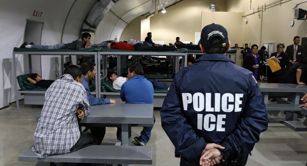 An Immigration and Customs Enforcement (ICE) officer guards a group of 116 Salvadorean immigrants that wait to be deported,at Willacy Detention facility in Raymondville, Texas on December 18, 2008